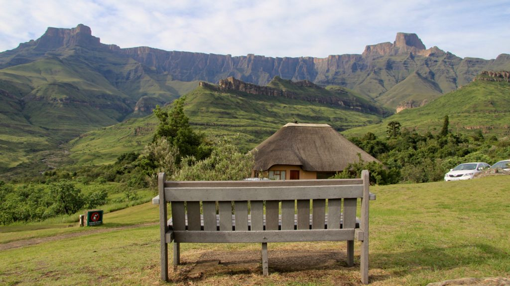An empty bench in front of the Amphitheatre in the Drakensberg Mountains