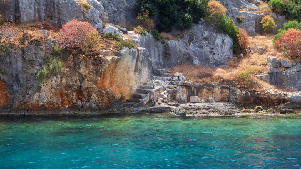 A staircase leads into the water and the sunken city of Kekova.