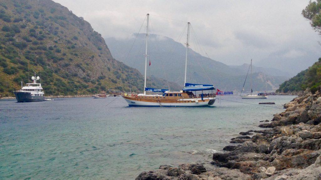Blue cruise gulet moored near Gemiler Island in the Turkish Aegean.