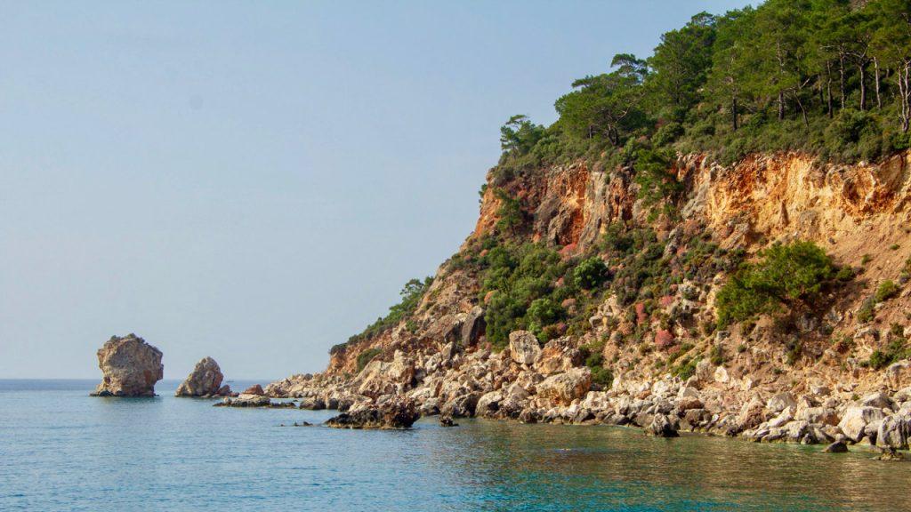 Cliffs meet the ocean on a Cypress Blue Cruise on the Turkish Aegean