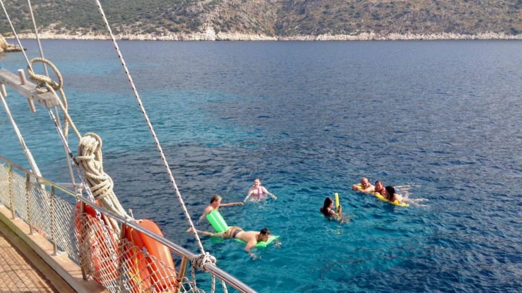 View from a gulet of Blue Cruise guests swimming in the Aegean.