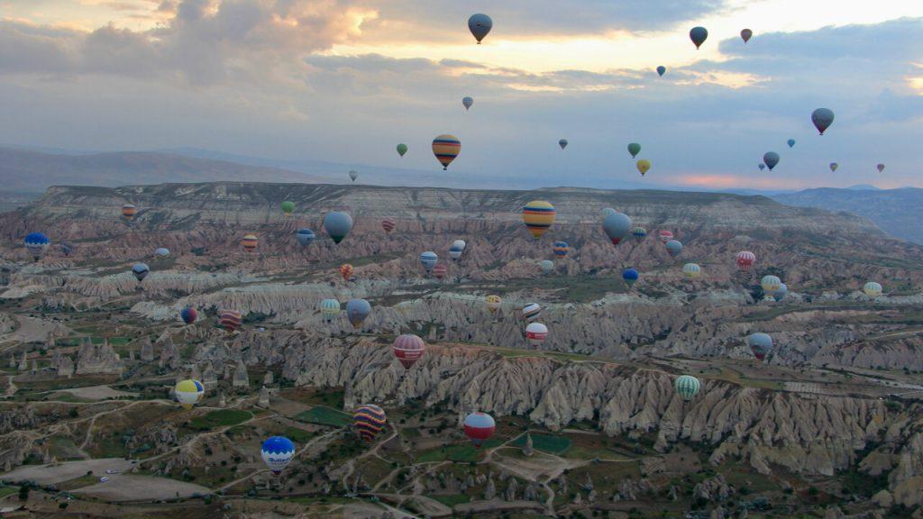 Hot air balloons effervesce into the dawn light