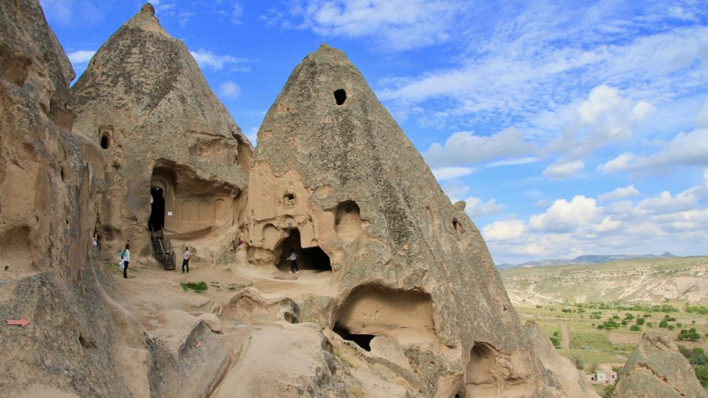 Crumbling rock cones of Selime Cathedral in Cappadocia