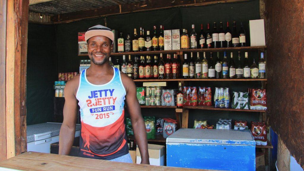 Man behind rustic bar counter