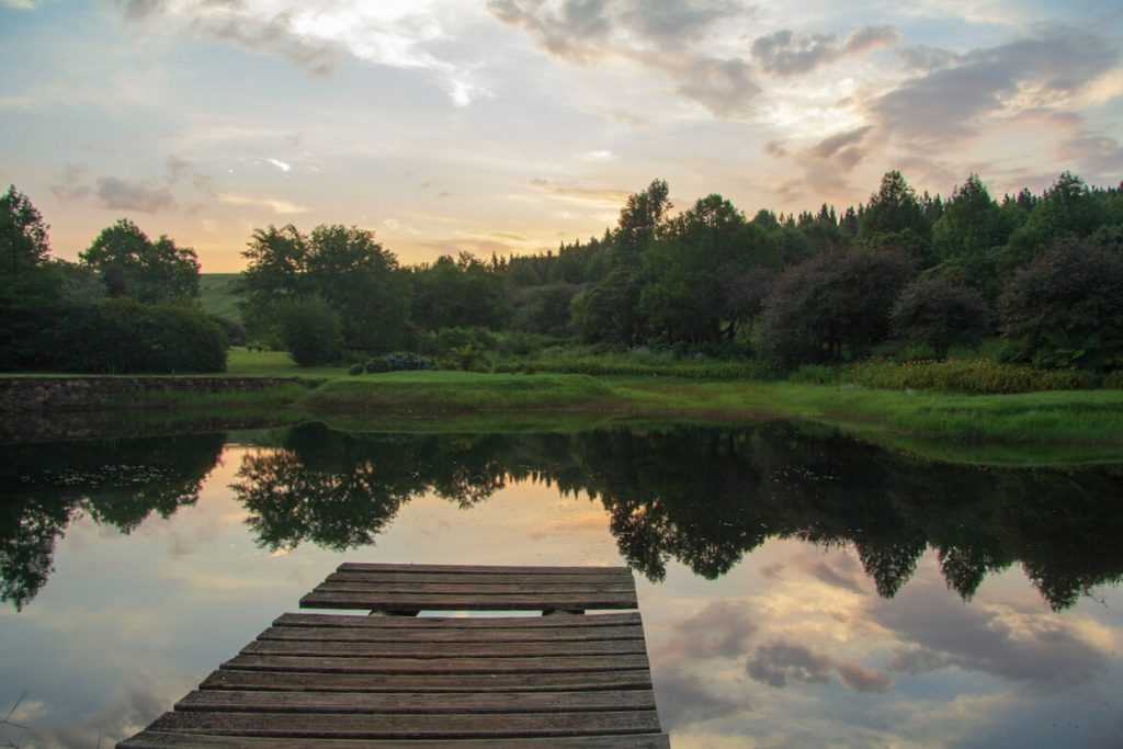 Pretty dam and fishing dock at sunset